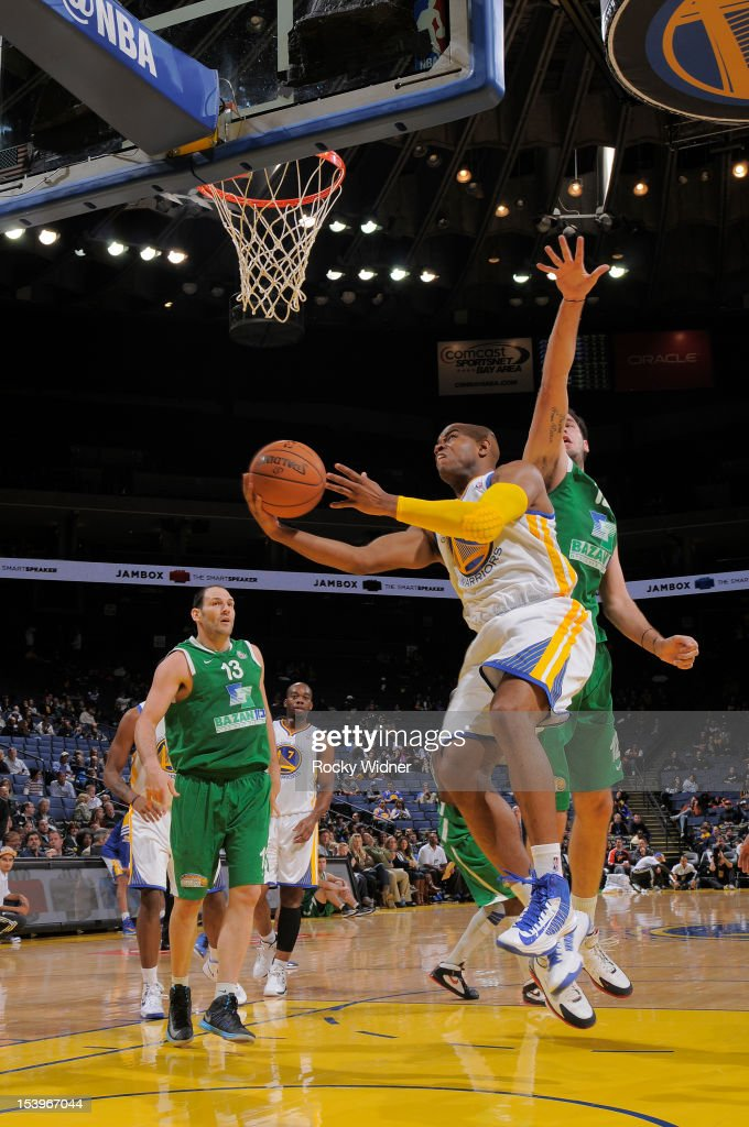 <a gi-track='captionPersonalityLinkClicked' href=/galleries/search?phrase=Jarrett+Jack&family=editorial&specificpeople=208109 ng-click='$event.stopPropagation()'>Jarrett Jack</a> #2 of the Golden State Warriors attempts a layup against Pat Calathes #12 of the Maccabi Haifa on October 11, 2012 at Oracle Arena in Oakland, California.