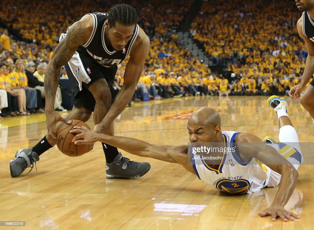 <a gi-track='captionPersonalityLinkClicked' href=/galleries/search?phrase=Jarrett+Jack&family=editorial&specificpeople=208109 ng-click='$event.stopPropagation()'>Jarrett Jack</a> #2 of the Golden State Warriors battles with <a gi-track='captionPersonalityLinkClicked' href=/galleries/search?phrase=Kawhi+Leonard&family=editorial&specificpeople=6691012 ng-click='$event.stopPropagation()'>Kawhi Leonard</a> #2 of the San Antonio Spurs in Game Four of the Western Conference Semifinals during the 2013 NBA Playoffs on May 12, 2013 at the Oracle Arena in Oakland, California.