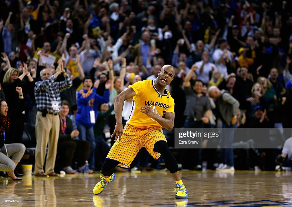 Jarrett Jack #2 of the Golden State Warriors celebrates after he made a three-point basket in the fourth period of their game against the San Antonio Spurs at Oracle Arena on February 22, 2013 in Oakland, California. The Warriors are wearing new short-sleeved uniforms for the first time. The Warriors won the game in overtime.