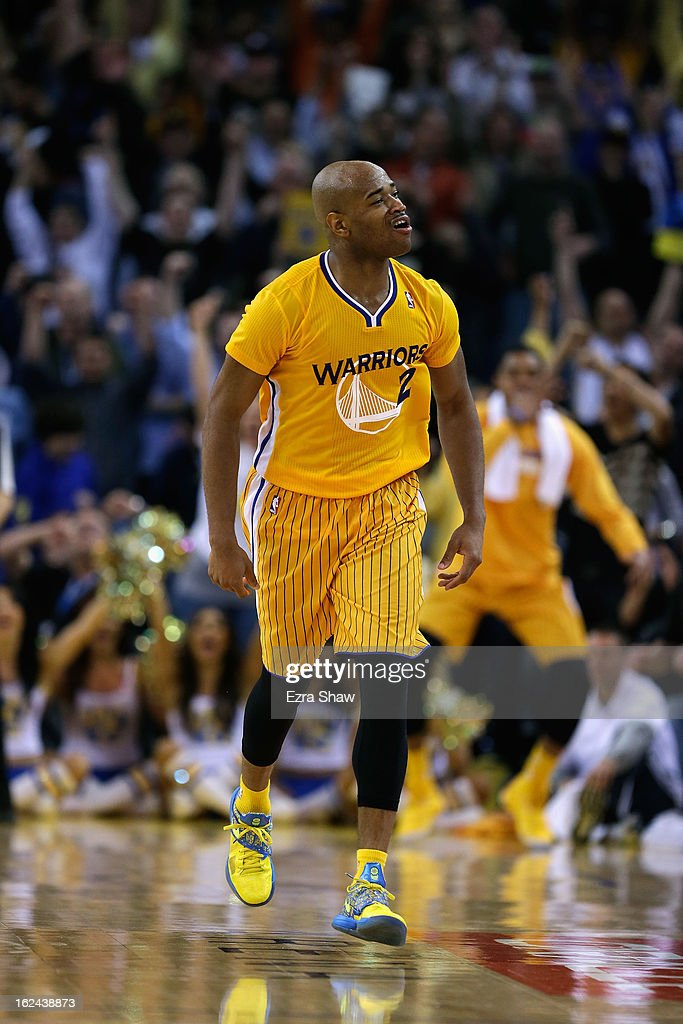 Jarrett Jack #2 of the Golden State Warriors celebrates after he made a basket during their game against the San Antonio Spurs at Oracle Arena on February 22, 2013 in Oakland, California. The Warriors are wearing new short-sleeved uniforms for the first time. The Warriors won the game in overtime.