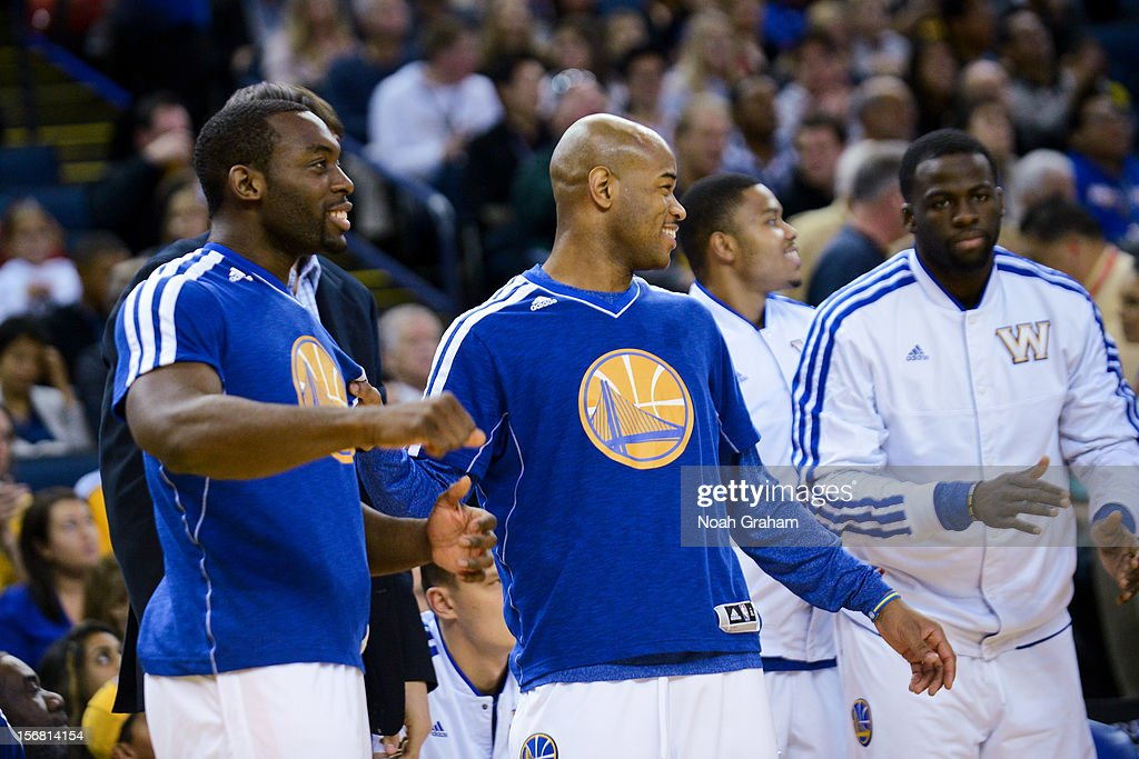 Jarrett Jack #2 of the Golden State Warriors celebrates from the sidelines as his teammates play the Brooklyn Nets at Oracle Arena on November 21, 2012 in Oakland, California.