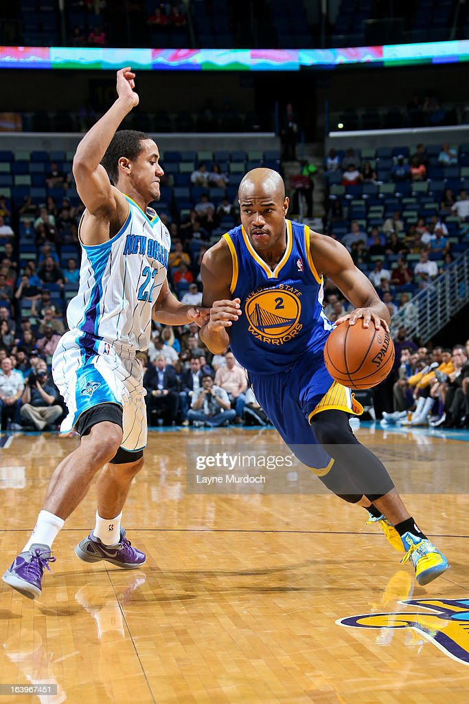 Jarrett Jack #2 of the Golden State Warriors drives against Brian Roberts #22 of the New Orleans Hornets on March 18, 2013 at the New Orleans Arena in New Orleans, Louisiana.