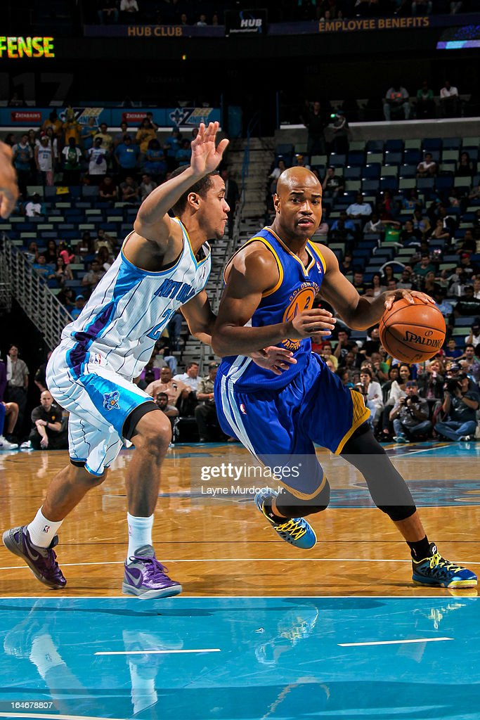 <a gi-track='captionPersonalityLinkClicked' href=/galleries/search?phrase=Jarrett+Jack&family=editorial&specificpeople=208109 ng-click='$event.stopPropagation()'>Jarrett Jack</a> #2 of the Golden State Warriors drives against Brian Roberts #22 of the New Orleans Hornets on March 18, 2013 at the New Orleans Arena in New Orleans, Louisiana.