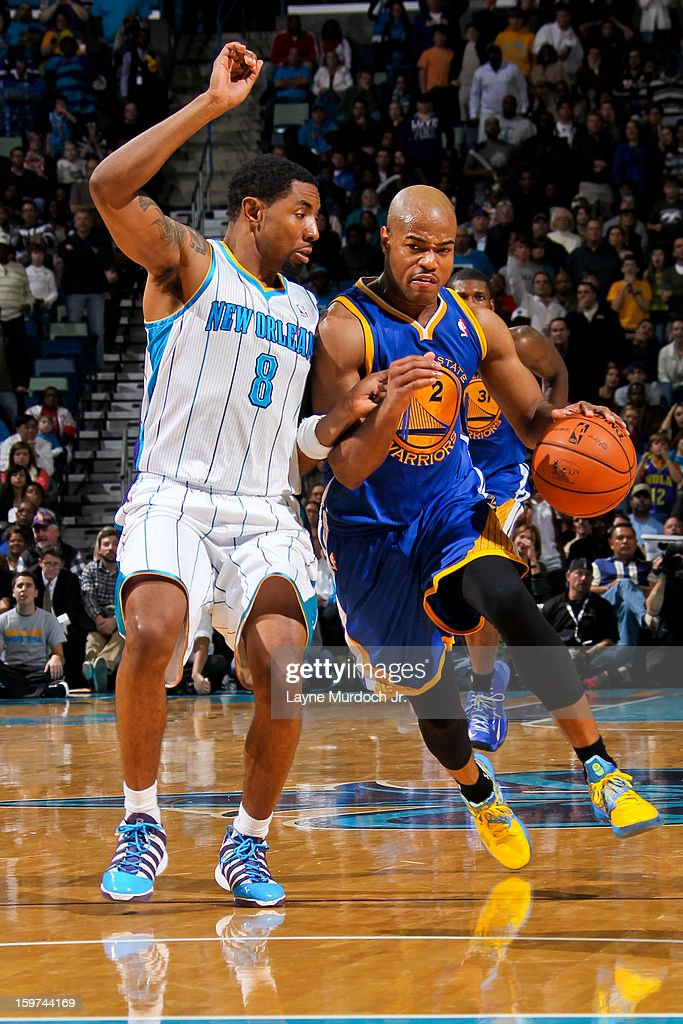 <a gi-track='captionPersonalityLinkClicked' href=/galleries/search?phrase=Jarrett+Jack&family=editorial&specificpeople=208109 ng-click='$event.stopPropagation()'>Jarrett Jack</a> #2 of the Golden State Warriors drives against <a gi-track='captionPersonalityLinkClicked' href=/galleries/search?phrase=Roger+Mason+Jr.&family=editorial&specificpeople=220399 ng-click='$event.stopPropagation()'>Roger Mason Jr.</a> #8 of the New Orleans Hornets on January 19, 2013 at the New Orleans Arena in New Orleans, Louisiana.