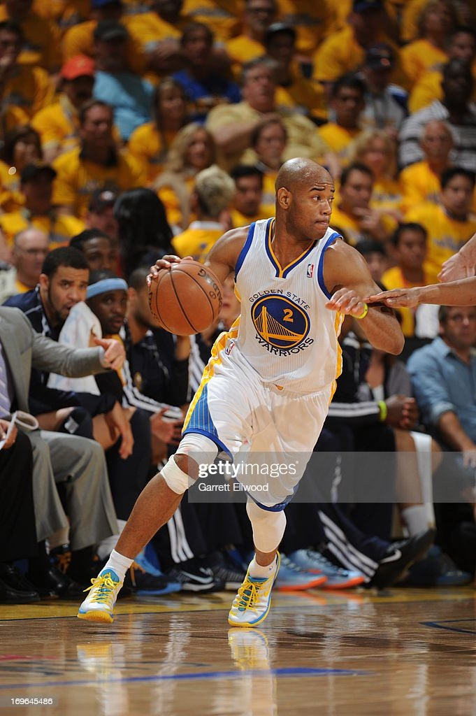 <a gi-track='captionPersonalityLinkClicked' href=/galleries/search?phrase=Jarrett+Jack&family=editorial&specificpeople=208109 ng-click='$event.stopPropagation()'>Jarrett Jack</a> #2 of the Golden State Warriors drives against the Denver Nuggets in Game Three of the Western Conference Quarterfinals during the 2013 NBA Playoffs on April 26, 2013 at the Oracle Arena in Oakland, California.