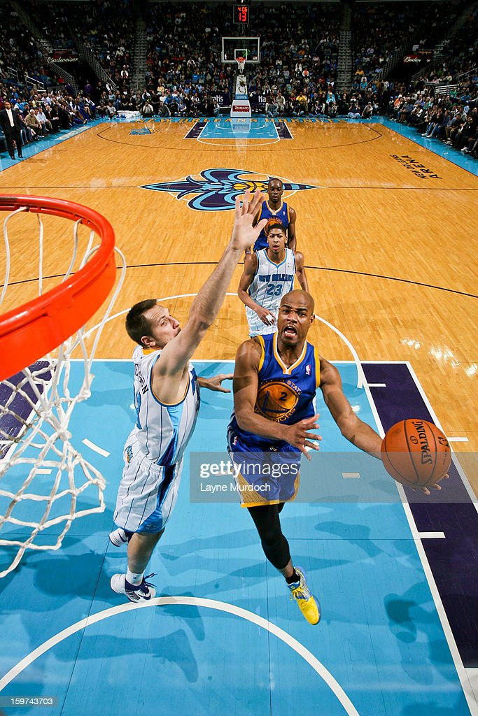 <a gi-track='captionPersonalityLinkClicked' href=/galleries/search?phrase=Jarrett+Jack&family=editorial&specificpeople=208109 ng-click='$event.stopPropagation()'>Jarrett Jack</a> #2 of the Golden State Warriors drives to the basket against Ryan Anderson #33 of the New Orleans Hornets on January 19, 2013 at the New Orleans Arena in New Orleans, Louisiana.