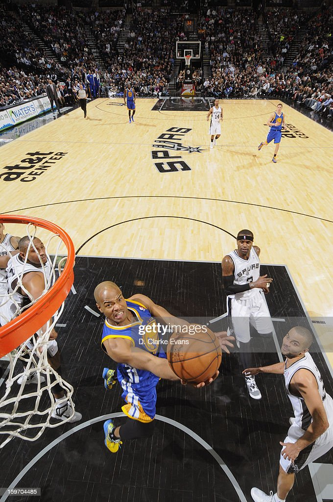 <a gi-track='captionPersonalityLinkClicked' href=/galleries/search?phrase=Jarrett+Jack&family=editorial&specificpeople=208109 ng-click='$event.stopPropagation()'>Jarrett Jack</a> #2 of the Golden State Warriors goes up for the reverse layup in a game against the San Antonio Spurs on January 18, 2013 at the AT&T Center in San Antonio, Texas.