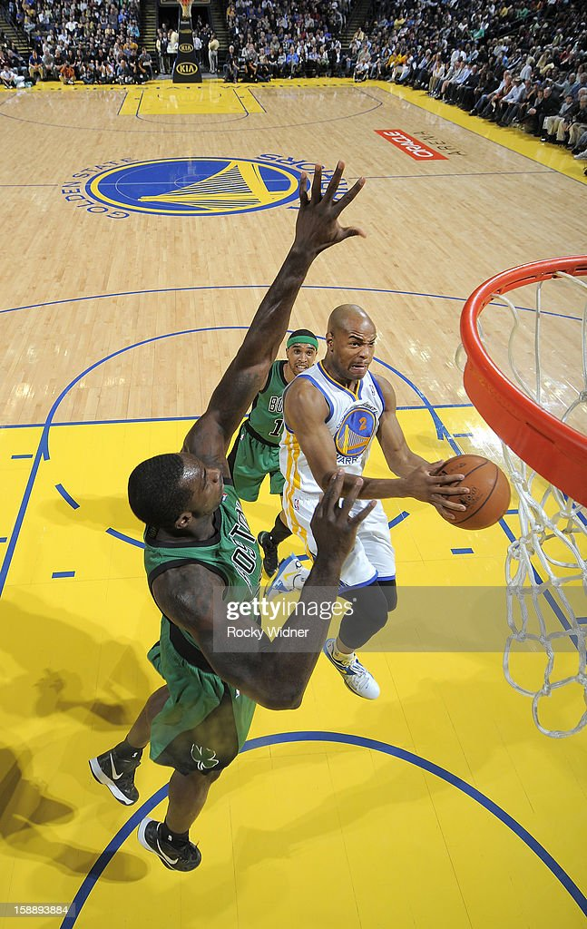 Jarrett Jack #2 of the Golden State Warriors goes up for the shot against Brandon Bass #30 of the Boston Celtics on December 29, 2012 at Oracle Arena in Oakland, California.
