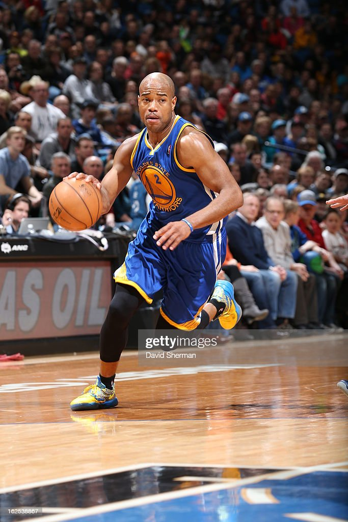 Jarrett Jack #2 of the Golden State Warriors handles the ball against the Minnesota Timberwolves on February 24, 2013 at Target Center in Minneapolis, Minnesota.