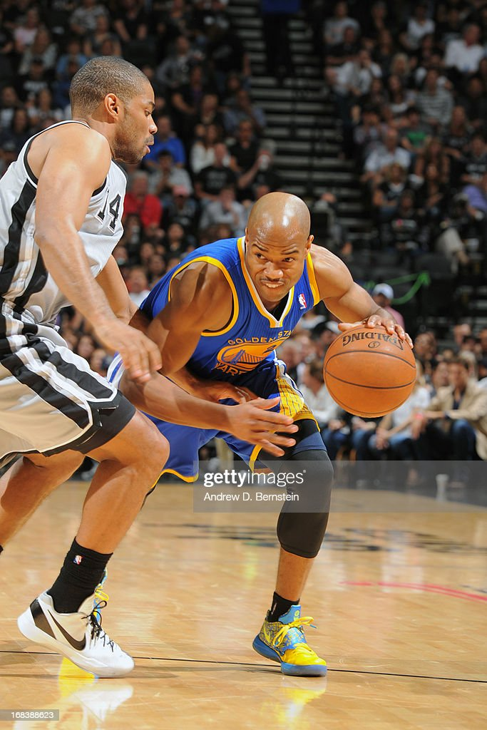<a gi-track='captionPersonalityLinkClicked' href=/galleries/search?phrase=Jarrett+Jack&family=editorial&specificpeople=208109 ng-click='$event.stopPropagation()'>Jarrett Jack</a> #2 of the Golden State Warriors handles the ball against <a gi-track='captionPersonalityLinkClicked' href=/galleries/search?phrase=Gary+Neal&family=editorial&specificpeople=5085165 ng-click='$event.stopPropagation()'>Gary Neal</a> #14 of the San Antonio Spurs in Game Two of the Western Conference Semifinals during the 2013 NBA Playoffs on May 8, 2013 at the AT&T Center in San Antonio, Texas.