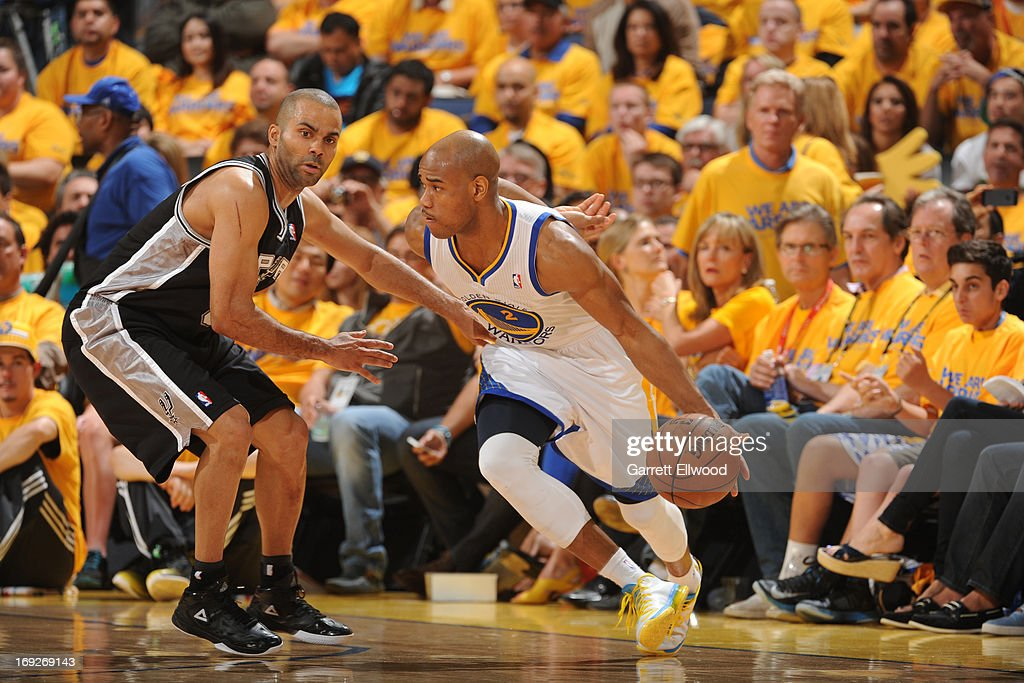 <a gi-track='captionPersonalityLinkClicked' href=/galleries/search?phrase=Jarrett+Jack&family=editorial&specificpeople=208109 ng-click='$event.stopPropagation()'>Jarrett Jack</a> #2 of the Golden State Warriors handles the ball against Tony Parker #9 of the San Antonio Spurs in Game Three of the Western Conference Semifinals during the 2013 NBA Playoffs on May 10, 2013 at the Oracle Arena in Oakland, California.