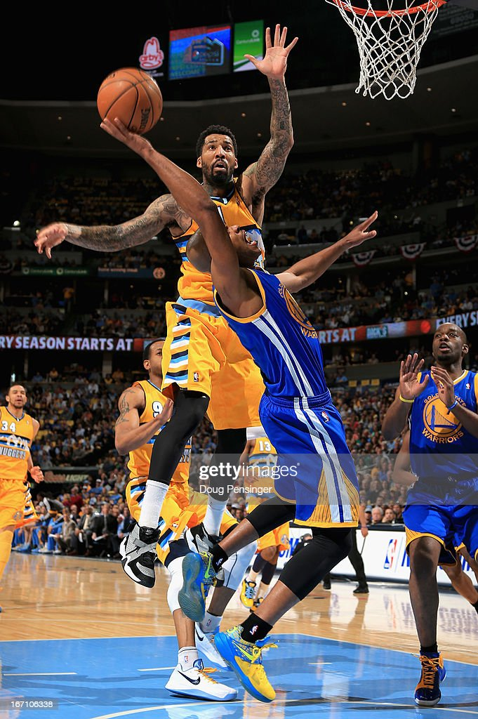 <a gi-track='captionPersonalityLinkClicked' href=/galleries/search?phrase=Jarrett+Jack&family=editorial&specificpeople=208109 ng-click='$event.stopPropagation()'>Jarrett Jack</a> #2 of the Golden State Warriors is fouled by <a gi-track='captionPersonalityLinkClicked' href=/galleries/search?phrase=Wilson+Chandler&family=editorial&specificpeople=809324 ng-click='$event.stopPropagation()'>Wilson Chandler</a> #21 of the Denver Nuggets during Game One of the Western Conference Quarterfinals of the 2013 NBA Playoffs at the Pepsi Center on April 20, 2013 in Denver, Colorado.