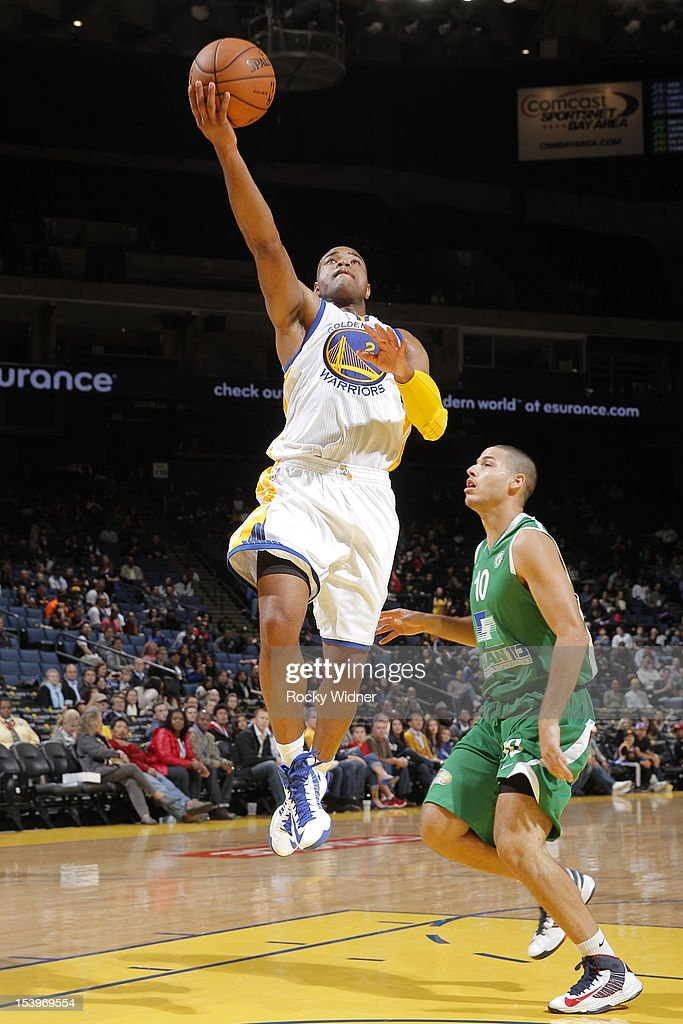 <a gi-track='captionPersonalityLinkClicked' href=/galleries/search?phrase=Jarrett+Jack&family=editorial&specificpeople=208109 ng-click='$event.stopPropagation()'>Jarrett Jack</a> #2 of the Golden State Warriors lays the ball against Lior Segev #10 of the Maccabi Haifa on October 11, 2012 at Oracle Arena in Oakland, California.