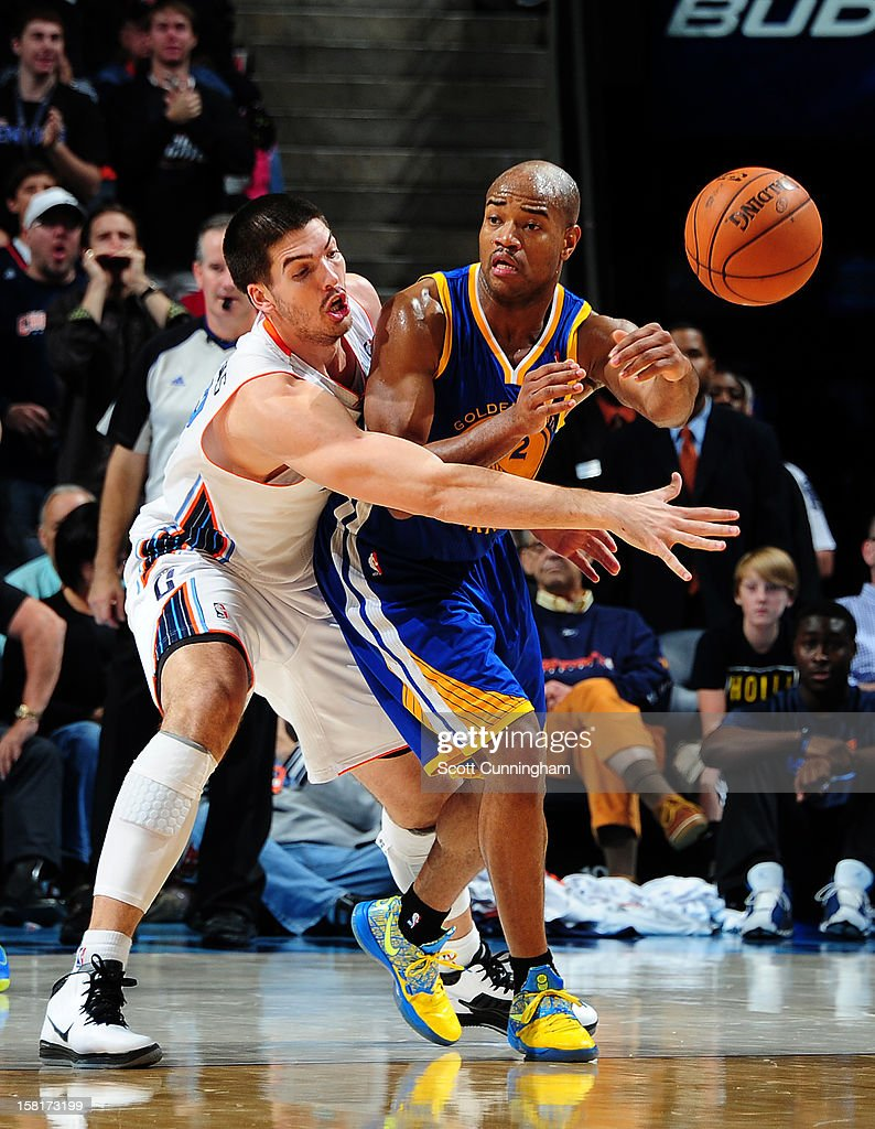 <a gi-track='captionPersonalityLinkClicked' href=/galleries/search?phrase=Jarrett+Jack&family=editorial&specificpeople=208109 ng-click='$event.stopPropagation()'>Jarrett Jack</a> #2 of the Golden State Warriors passes the ball against Byron Mullens #22 of the Charlotte Bobcats at Time Warner Cable Arena on December 10, 2012 in Charlotte, North Carolina.