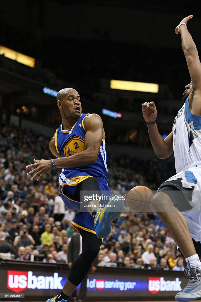 Jarrett Jack #2 of the Golden State Warriors passes the ball against the Minnesota Timberwolves on February 24, 2013 at Target Center in Minneapolis, Minnesota.