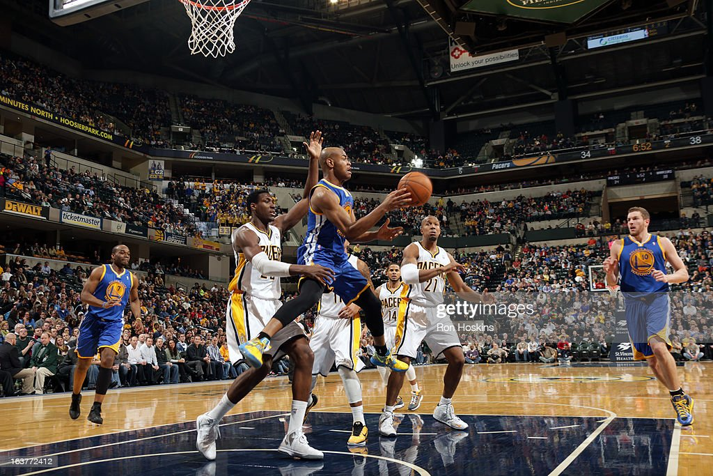 Jarrett Jack #2 of the Golden State Warriors passes the ball against the Indiana Pacers on February 26, 2013 at Bankers Life Fieldhouse in Indianapolis, Indiana.