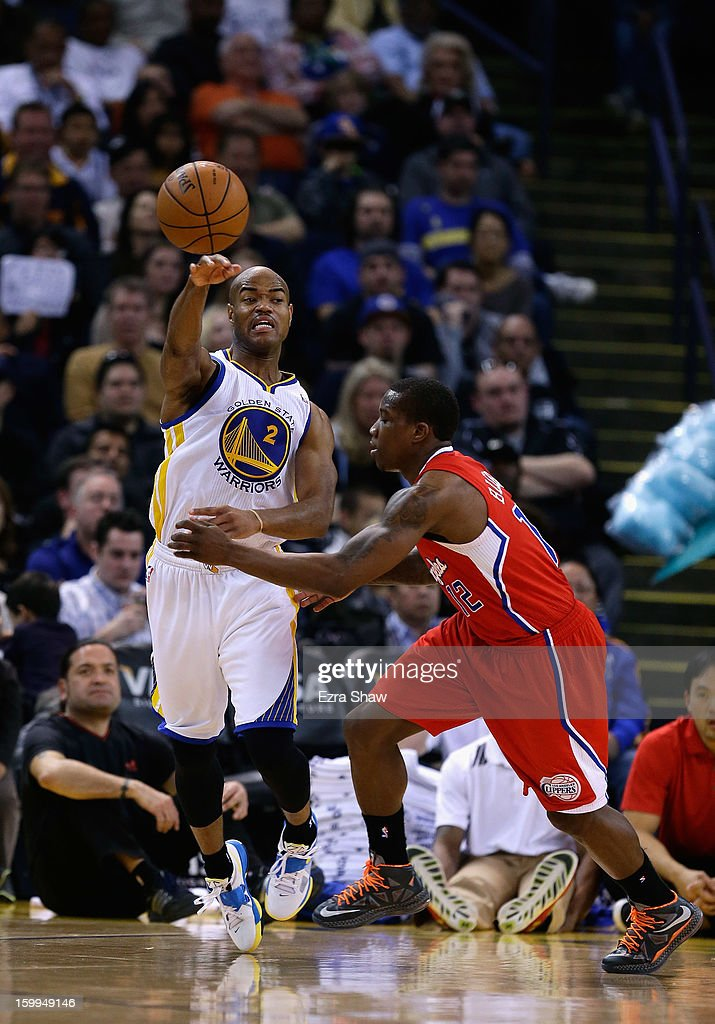Jarrett Jack #2 of the Golden State Warriors passes the ball around Eric Bledsoe #12 of the Los Angeles Clippers at Oracle Arena on January 21, 2013 in Oakland, California.