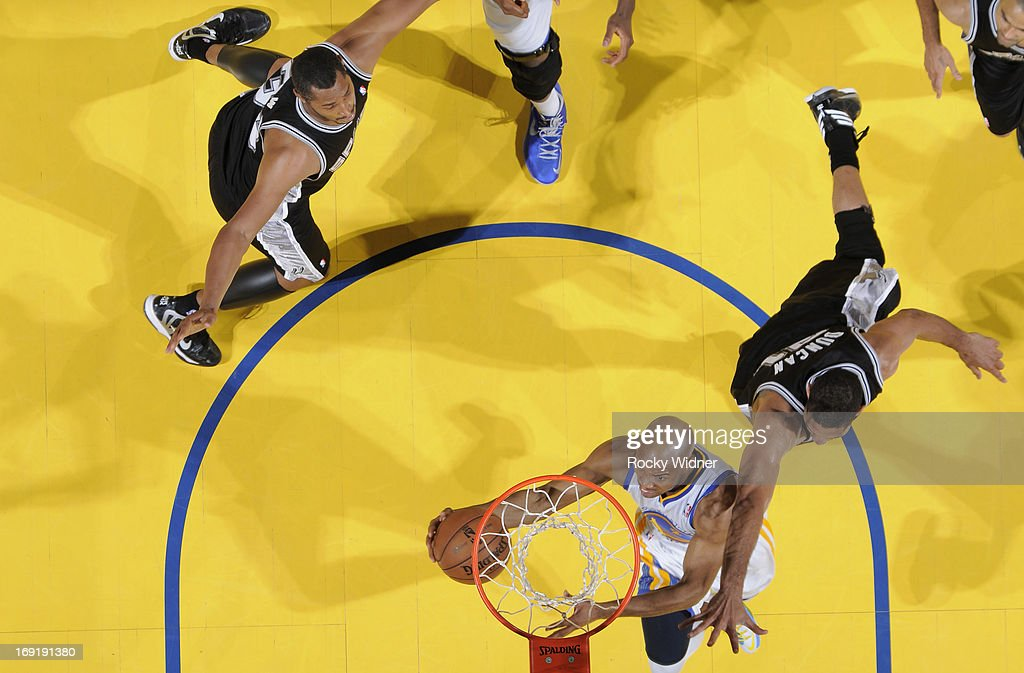 Jarrett Jack #2 of the Golden State Warriors puts up a shot against Tim Duncan #21 of the San Antonio Spurs in Game Six of the Western Conference Semifinals during the 2013 NBA Playoffs on May 16, 2013 at Oracle Arena in Oakland, California.