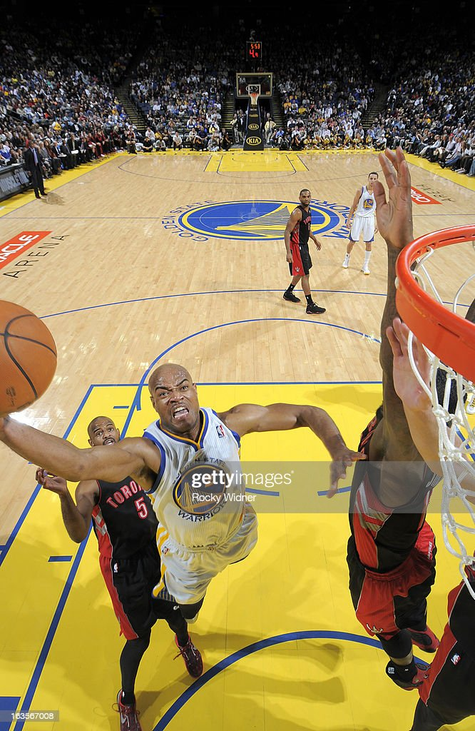 <a gi-track='captionPersonalityLinkClicked' href=/galleries/search?phrase=Jarrett+Jack&family=editorial&specificpeople=208109 ng-click='$event.stopPropagation()'>Jarrett Jack</a> #2 of the Golden State Warriors shoots a layup against the Toronto Raptors on March 4, 2013 at Oracle Arena in Oakland, California.