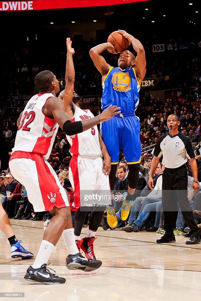 <a gi-track='captionPersonalityLinkClicked' href=/galleries/search?phrase=Jarrett+Jack&family=editorial&specificpeople=208109 ng-click='$event.stopPropagation()'>Jarrett Jack</a> #2 of the Golden State Warriors shoots a three-pointer against John Lucas #5 and Ed Davis #32 of the Toronto Raptors on January 28, 2013 at the Air Canada Centre in Toronto, Ontario, Canada.