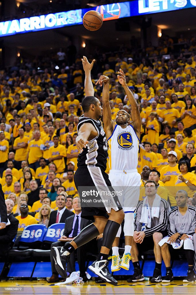 Jarrett Jack #2 of the Golden State Warriors shoots a three-pointer against Boris Diaw #33 of the San Antonio Spurs in Game Six of the Western Conference Semifinals during the 2013 NBA Playoffs on May 16, 2013 at Oracle Arena in Oakland, California.