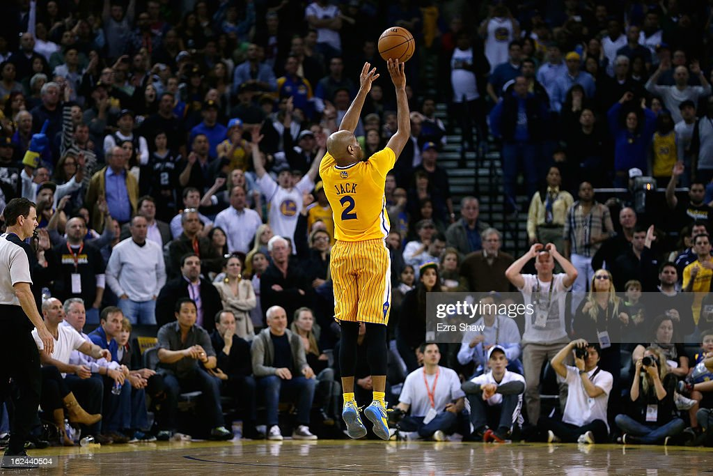Jarrett Jack #2 of the Golden State Warriors shoots a three-pointer against the San Antonio Spurs at Oracle Arena on February 22, 2013 in Oakland, California. The Warriors are wearing new short-sleeved uniforms for the first time. The Warriors won the game in overtime.