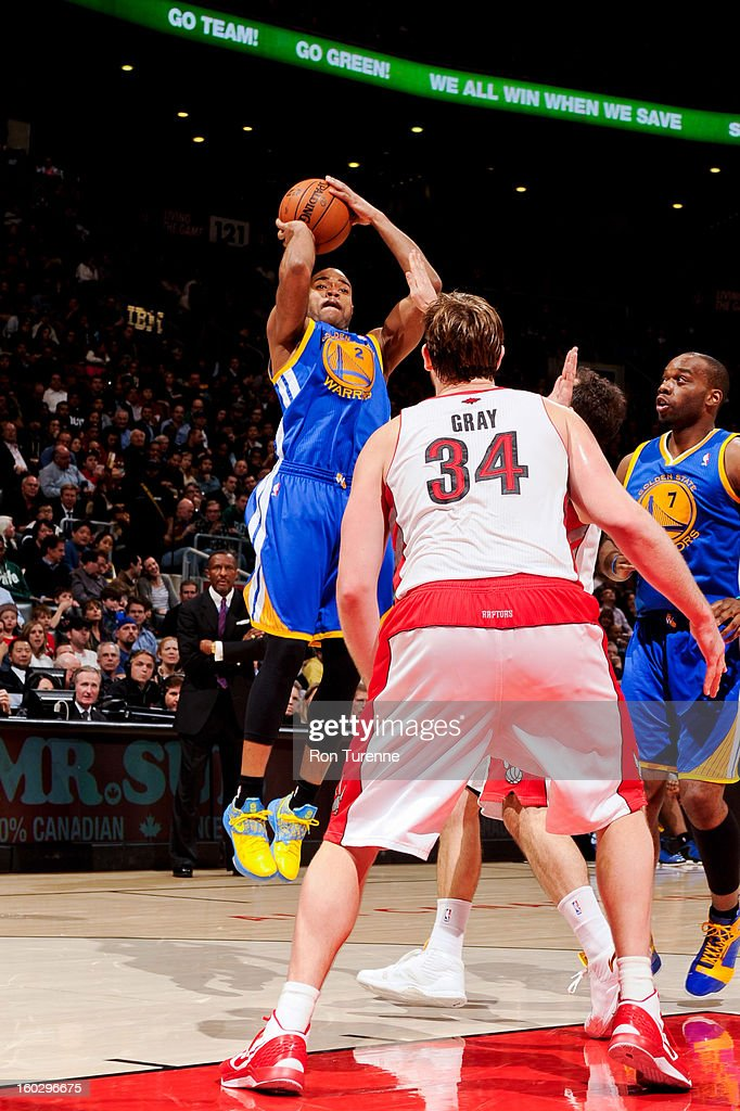 <a gi-track='captionPersonalityLinkClicked' href=/galleries/search?phrase=Jarrett+Jack&family=editorial&specificpeople=208109 ng-click='$event.stopPropagation()'>Jarrett Jack</a> #2 of the Golden State Warriors shoots against <a gi-track='captionPersonalityLinkClicked' href=/galleries/search?phrase=Aaron+Gray+-+Jugador+de+baloncesto&family=editorial&specificpeople=666453 ng-click='$event.stopPropagation()'>Aaron Gray</a> #34 of the Toronto Raptors on January 28, 2013 at the Air Canada Centre in Toronto, Ontario, Canada.