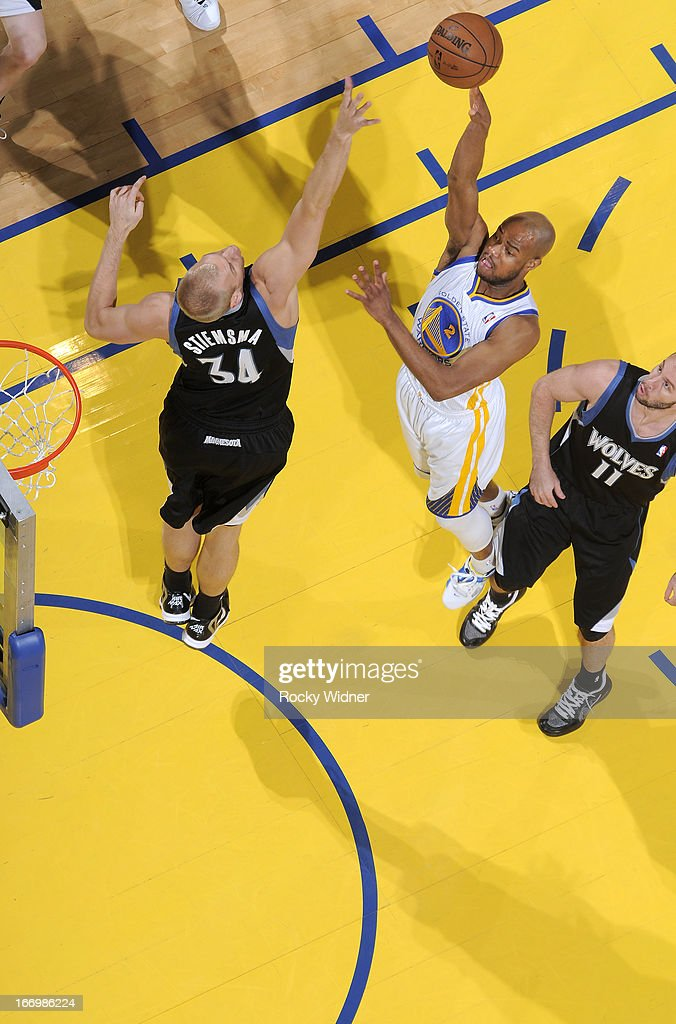 <a gi-track='captionPersonalityLinkClicked' href=/galleries/search?phrase=Jarrett+Jack&family=editorial&specificpeople=208109 ng-click='$event.stopPropagation()'>Jarrett Jack</a> #2 of the Golden State Warriors shoots against <a gi-track='captionPersonalityLinkClicked' href=/galleries/search?phrase=Greg+Stiemsma&family=editorial&specificpeople=2098297 ng-click='$event.stopPropagation()'>Greg Stiemsma</a> #34 of the Minnesota Timberwolves on April 9, 2013 at Oracle Arena in Oakland, California.