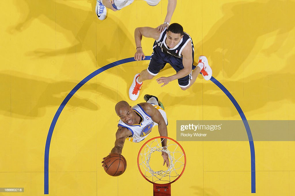 <a gi-track='captionPersonalityLinkClicked' href=/galleries/search?phrase=Jarrett+Jack&family=editorial&specificpeople=208109 ng-click='$event.stopPropagation()'>Jarrett Jack</a> #2 of the Golden State Warriors shoots against <a gi-track='captionPersonalityLinkClicked' href=/galleries/search?phrase=Kevin+Martin+-+Basketball+Player&family=editorial&specificpeople=204503 ng-click='$event.stopPropagation()'>Kevin Martin</a> #12 of the Oklahoma City Thunder on April 11, 2013 at Oracle Arena in Oakland, California.