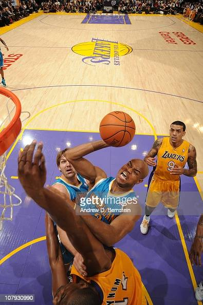 Jarrett Jack of the New Orleans Hornets goes up for a shot against Andrew Bynum of the Los Angeles Lakers at Staples Center on January 7 2011 in Los...