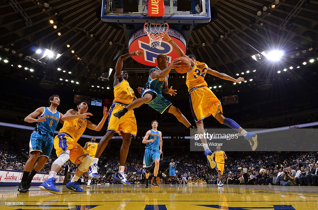 <a gi-track='captionPersonalityLinkClicked' href=/galleries/search?phrase=Jarrett+Jack&family=editorial&specificpeople=208109 ng-click='$event.stopPropagation()'>Jarrett Jack</a> #2 of the New Orleans Hornets looks for a teammate to dish to after driving the ball against <a gi-track='captionPersonalityLinkClicked' href=/galleries/search?phrase=Ekpe+Udoh&family=editorial&specificpeople=4185351 ng-click='$event.stopPropagation()'>Ekpe Udoh</a> #20 and <a gi-track='captionPersonalityLinkClicked' href=/galleries/search?phrase=Brandan+Wright&family=editorial&specificpeople=3847557 ng-click='$event.stopPropagation()'>Brandan Wright</a> #32 of the Golden State Warriors on February 15, 2011 at Oracle Arena in Oakland, California.