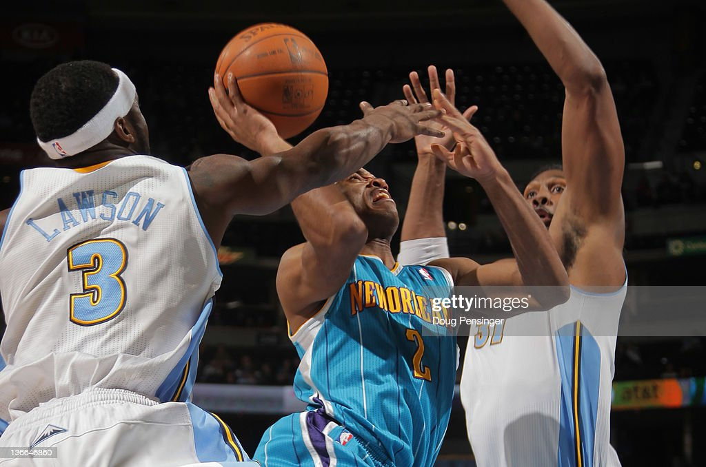 <a gi-track='captionPersonalityLinkClicked' href=/galleries/search?phrase=Jarrett+Jack&family=editorial&specificpeople=208109 ng-click='$event.stopPropagation()'>Jarrett Jack</a> #2 of the New Orleans Hornets tries to get off a shot against <a gi-track='captionPersonalityLinkClicked' href=/galleries/search?phrase=Ty+Lawson&family=editorial&specificpeople=4024882 ng-click='$event.stopPropagation()'>Ty Lawson</a> #3 of the Denver Nuggets and has it blocked by <a gi-track='captionPersonalityLinkClicked' href=/galleries/search?phrase=Nene+Hilario+-+Basketball&family=editorial&specificpeople=4250456 ng-click='$event.stopPropagation()'>Nene Hilario</a> #31 of the Denver Nuggets at the Pepsi Center on January 9, 2012 in Denver, Colorado.