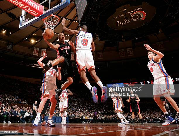 Jarrett Jack of the Toronto Raptors passes against Jonathan Bender of the New York Knicks on January 15 2010 at Madison Square Garden in New York...