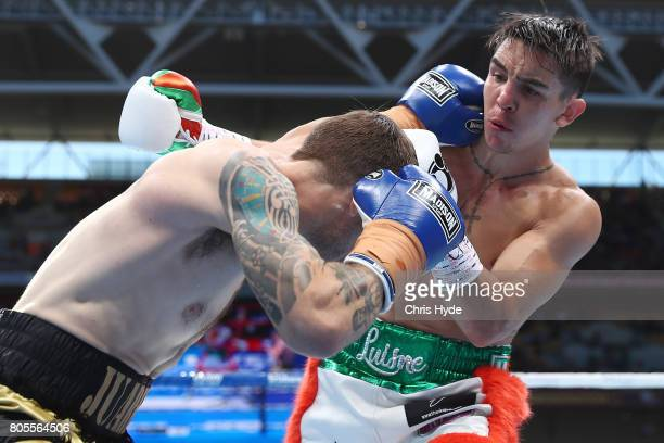 Jarrett Owen of Australia and Michael Conlan of Ireland exchange punches during their Featherweight bout before the WBO Welterweight Title Fight...