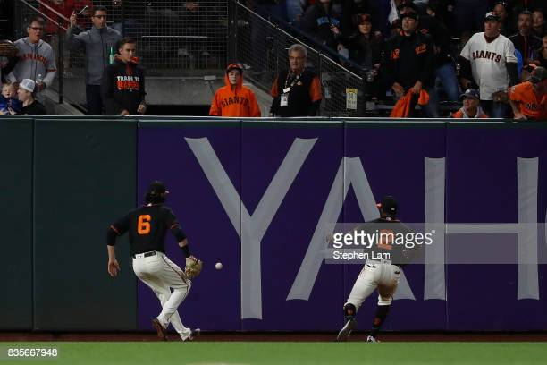 Jarrett Parker and Denard Span chase the ball in centerfield during the sixth inning against the Philadelphia Phillies at ATT Park on August 19 2017...