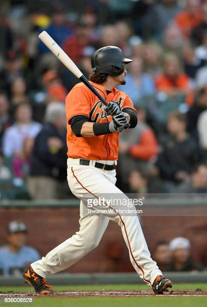 Jarrett Parker of the San Francisco Giants hits a tworun rbi double against the Philadelphia Phillies in the bottom of the first inning at ATT Park...