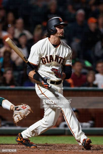 Jarrett Parker of the San Francisco Giants hits an RBI double against the Oakland Athletics during the fifth inning at ATT Park on August 3 2017 in...