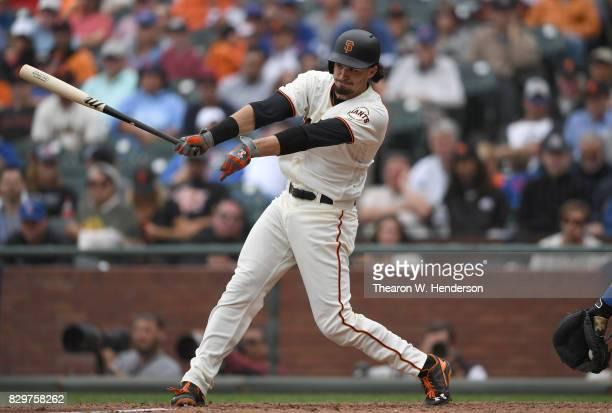 Jarrett Parker of the San Francisco Giants hits an rbi single scoring Denard Span against the Chicago Cubs in the bottom of the seventh inning at ATT...