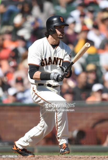 Jarrett Parker of the San Francisco Giants hits an rbi single scoring Buster Posey against the San Diego Padres in the bottom of the fourth inning at...