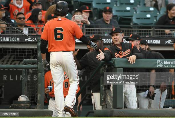 Jarrett Parker of the San Francisco Giants is congratulated by manager Bruce Bochy after Pence scored against the Philadelphia Phillies in the bottom...