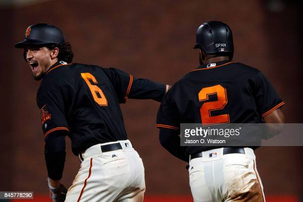 Jarrett Parker of the San Francisco Giants is congratulated by Denard Span after hitting a walk off single in the tenth inning against the Arizona...
