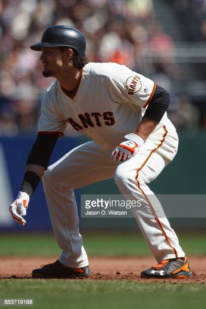 Jarrett Parker of the San Francisco Giants leads off first base against the Arizona Diamondbacks during the second inning at ATT Park on September 17...