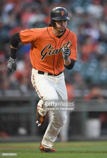 Jarrett Parker of the San Francisco Giants runs the bases with a tworun rbi double against the Philadelphia Phillies in the bottom of the first...