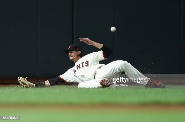 Jarrett Parker of the San Francisco Giants tries unsuccessfully to catch a ball hit by Freddy Galvis of the Philadelphia Phillies in the seventh...