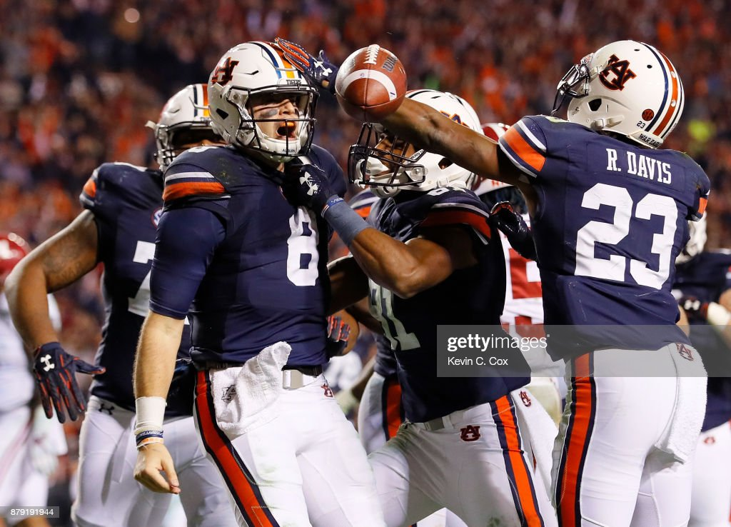 Jarrett Stidham #8 of the Auburn Tigers celebrates with teammates after rushing for a touchdown against the Alabama Crimson Tide at Jordan Hare Stadium on November 25, 2017 in Auburn, Alabama.