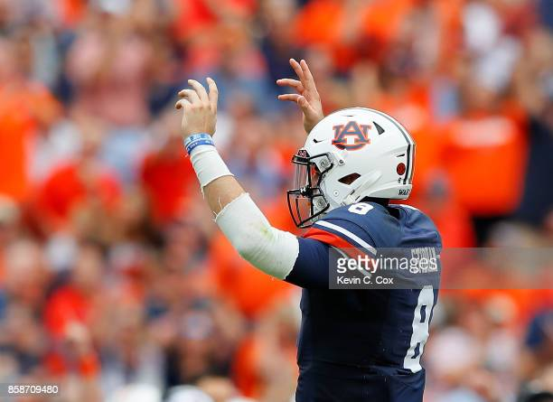 Jarrett Stidham of the Auburn Tigers reacts after passing for a touchdown against the Mississippi Rebels at Jordan Hare Stadium on October 7 2017 in...