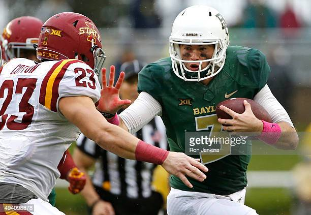 Jarrett Stidham of the Baylor Bears runs against Darian Cotton of the Iowa State Cyclones in the second half at McLane Stadium on October 24 2015 in...