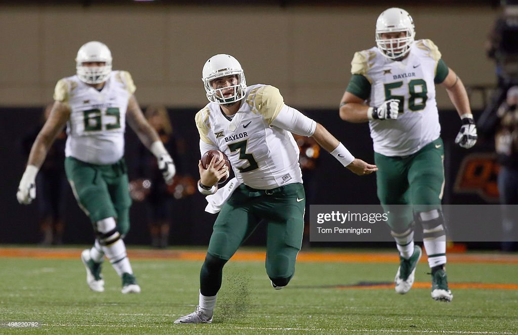 <a gi-track='captionPersonalityLinkClicked' href=/galleries/search?phrase=Jarrett+Stidham&family=editorial&specificpeople=11403615 ng-click='$event.stopPropagation()'>Jarrett Stidham</a> #3 of the Baylor Bears scrambles with the ball against the Oklahoma State Cowboys in the second quarter at Boone Pickens Stadium on November 21, 2015 in Stillwater, Oklahoma.