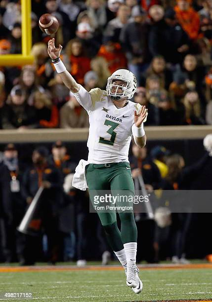 Jarrett Stidham of the Baylor Bears throws a touchdown pass turnover KD Cannon of the Baylor Bears in the first quarter against the Oklahoma State...