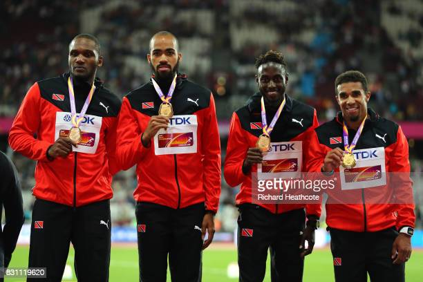 Jarrin Solomon Jereem Richards Machel Cedenio and Lalonde Gordon of Trinidad and Tobago gold pose with their medals for the Men's 4x400 Metres Relay...